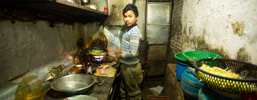 boy-from-poorer-area-working-in-the-kitchen-Nepal